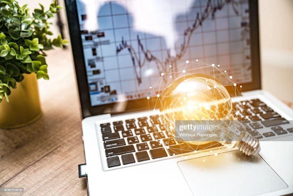 Closeup light bulb on keyboard laptop, New ideas, innovation, inspiration and creativity concept. : Stock Photo