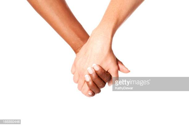 Close-up Light skinned and dark skinned people holding hands