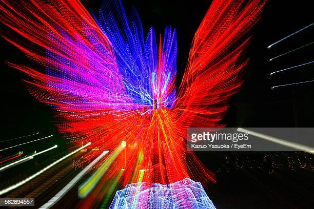 close-up light trails of phoenix at night - phoenix bird stock pictures, royalty-free photos & images
