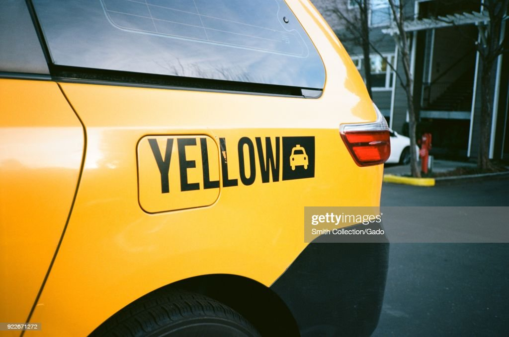 Close-up logo for Yellow Cab taxi company, on a vehicle in Dublin