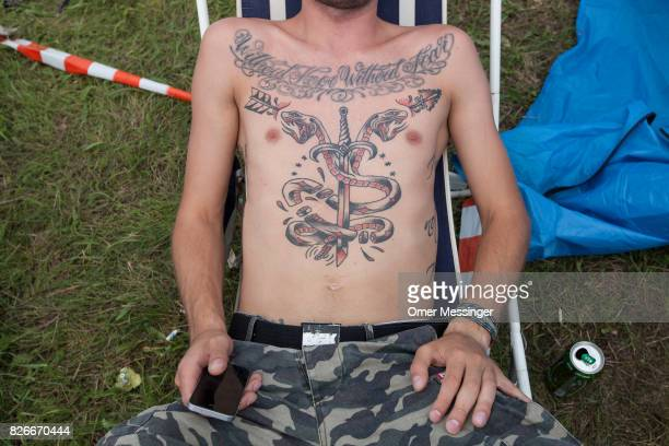 A closeup look a festival goer's tattoo at the 2017 Woodstock Festival Poland on August 4 2017 in Kostrzyn Poland The threeday rock music festival...