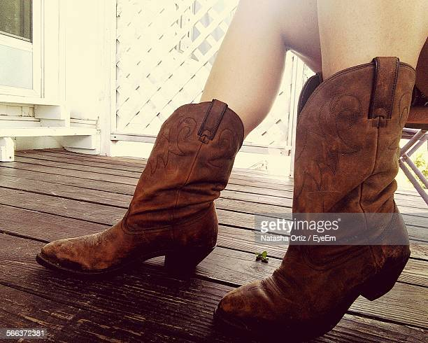 Close-Up Low Section Of Woman Wearing Boots