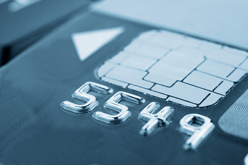 Close-Up Metallic Numbers on a Chip Card - gettyimageskorea