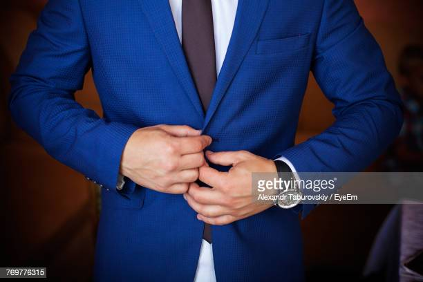 close-up midsection of man wearing blue suit - blue suit stock pictures, royalty-free photos & images