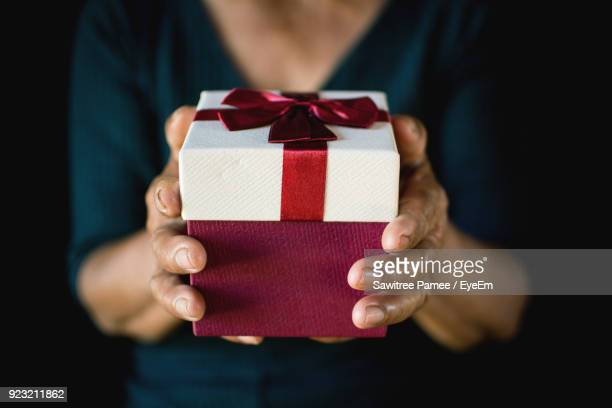 Close-Up Midsection Of Woman Holding Gift Box