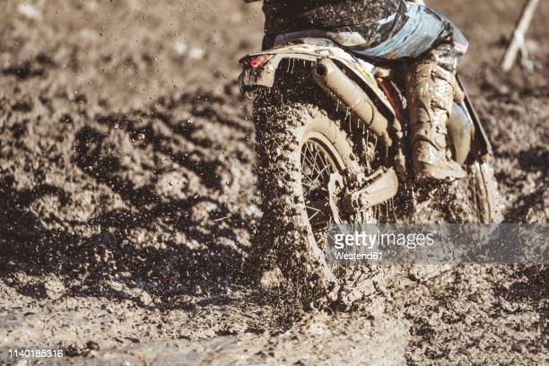 close-up motocross wheel with water and mud - ecchi biker stock pictures, royalty-free photos & images