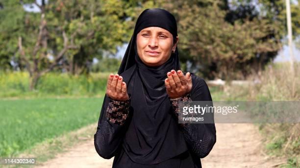 close-up muslim woman praying to god, namaj time - salah islamic prayer stock pictures, royalty-free photos & images