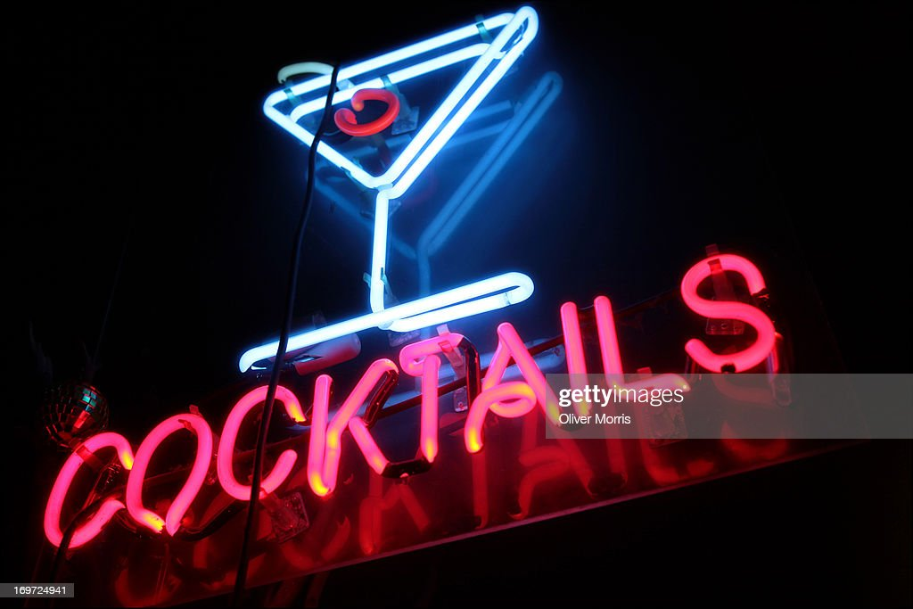 Close-up, nighttime view of a neon 'Cocktails' sign in the window of Benash Delicatessen (857 7th Avenue, between 54th and 55th streets), Manhattan, New York, New York, March 31, 2013.