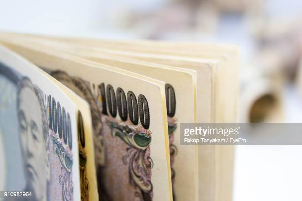 close-up of 10000 japanese yen notes - japanese yen note stock photos and pictures