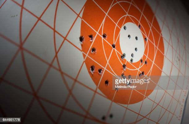 close-up of 100-yard target with bullet holes - sportschießen stock-fotos und bilder