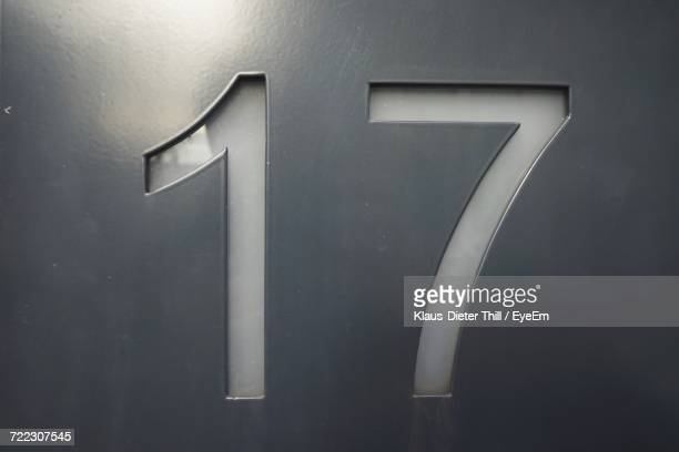 Close-Up Of 17 Number On Wall