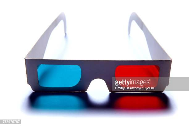 Close-Up Of 3-D Glasses On Table Against White Background