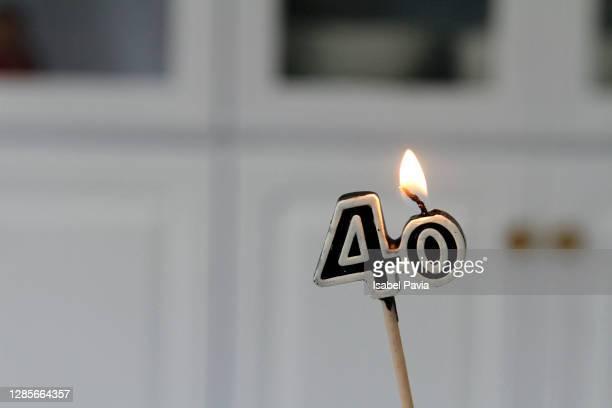close-up of 40 birthday candle - 数字の40 ストックフォトと画像