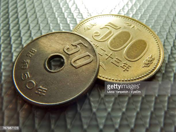 Close-Up Of 50 And 500 Yen On Metallic Table