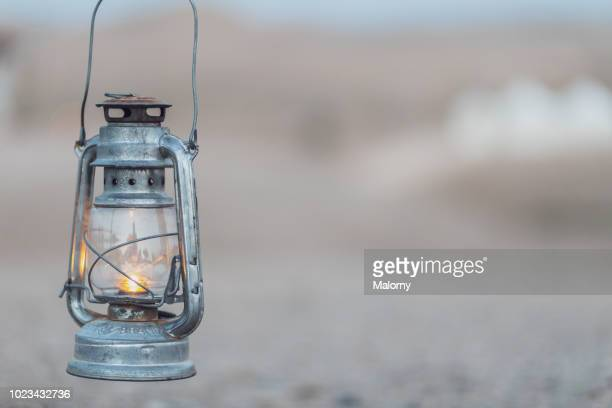 close-up of a an oil lamp at a desert camp. moroccan desert near marrakesh, morocco. - oil lamp stock pictures, royalty-free photos & images
