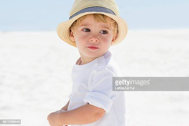 close-up of a baby boy on the beach - one baby boy only stock pictures, royalty-free photos & images