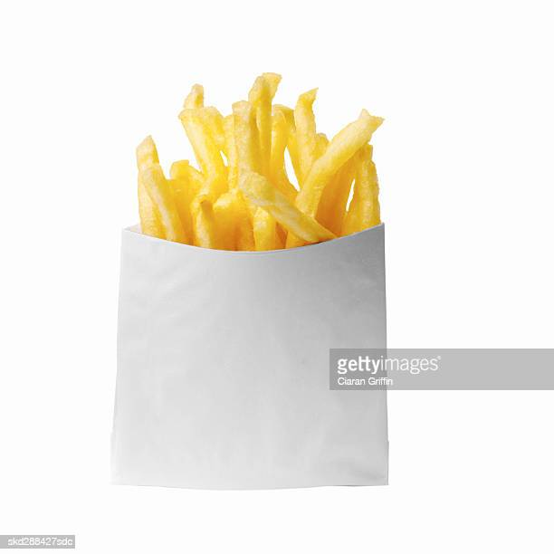 close-up of a bag of french-fries - fast food french fries stock pictures, royalty-free photos & images