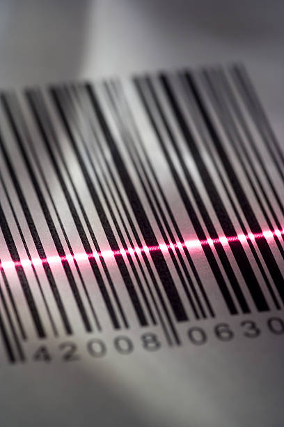 Close-up of a bar code being scanned with a laser light