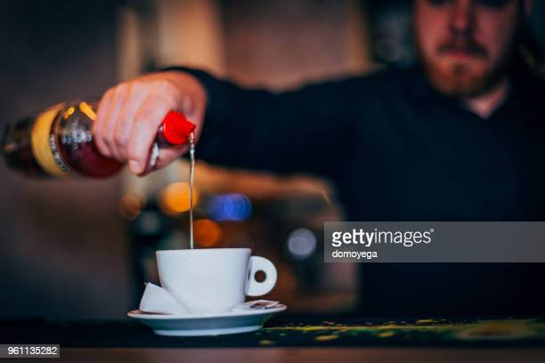Close-up of a bartender making coffee on the bar counter
