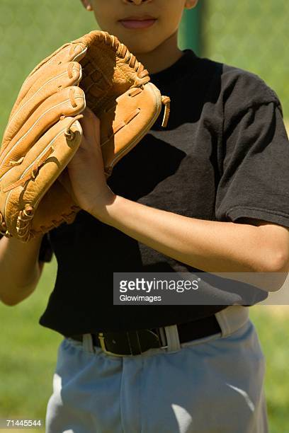 Close-up of a baseball player standing in a baseball field