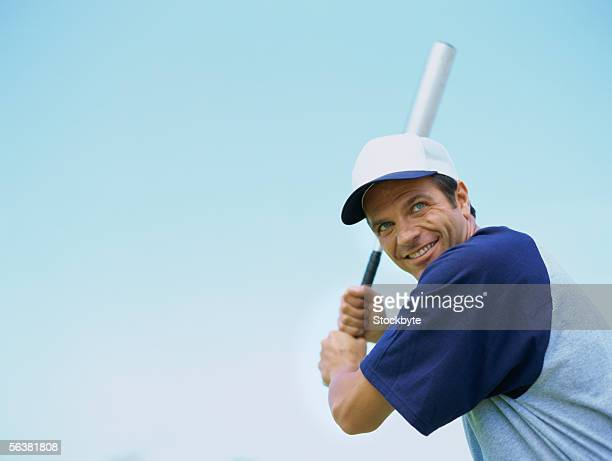 close-up of a baseball player swinging a baseball bat - bastão de beisebol - fotografias e filmes do acervo