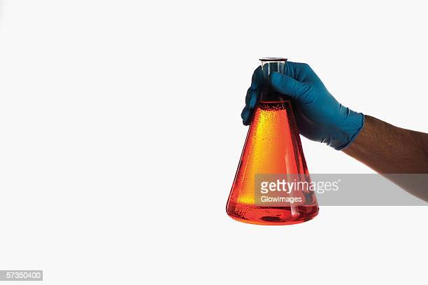 close-up of a beaker in a person's hand - beaker stock pictures, royalty-free photos & images