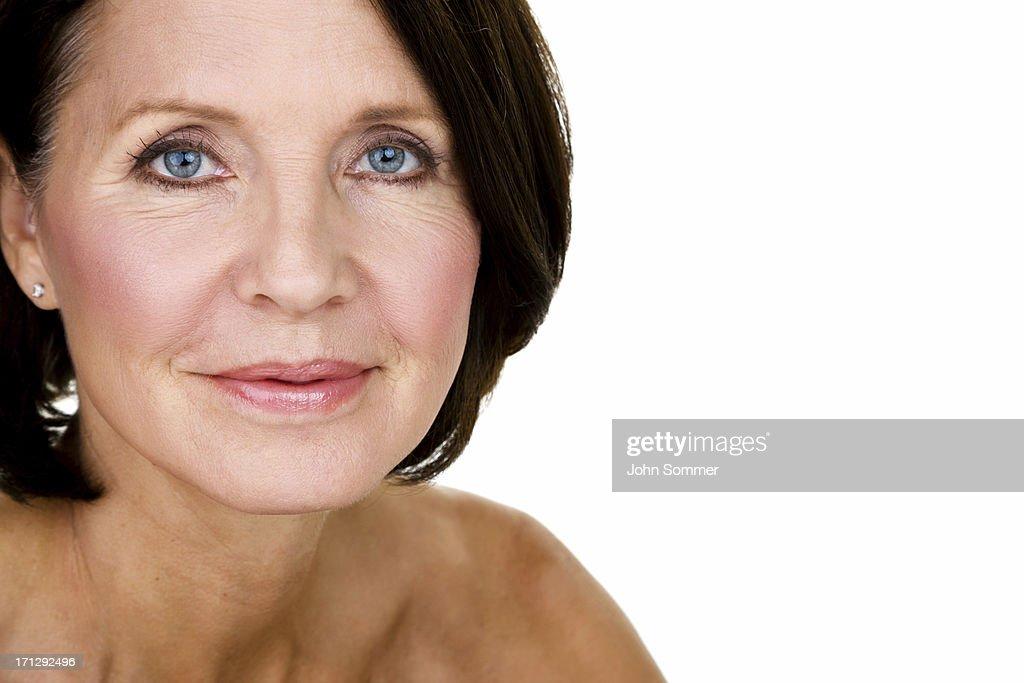 Closeup of a beautiful mature woman : Stock Photo