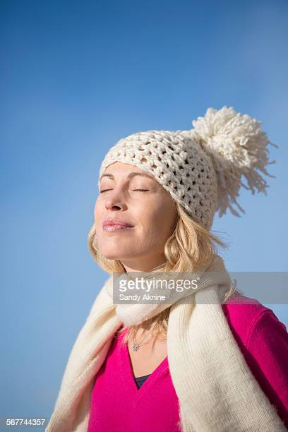 close-up of a beautiful woman day dreaming, crans-montana, swiss alps, switzerland - einzelne frau über 40 stock-fotos und bilder