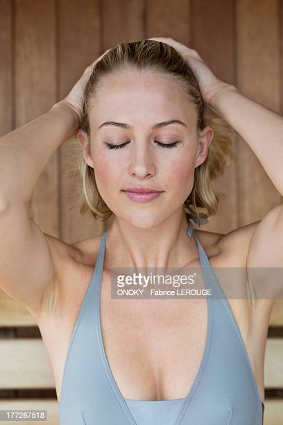 Close-up of a beautiful woman in a sauna