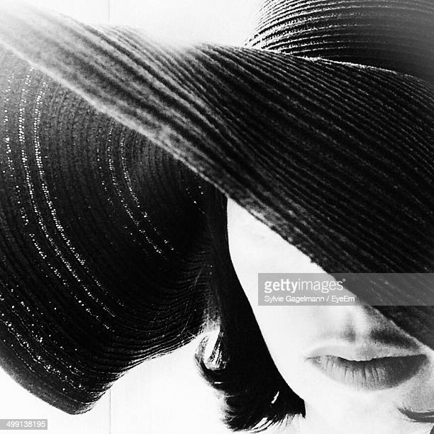 Close-up of a beautiful woman in hat