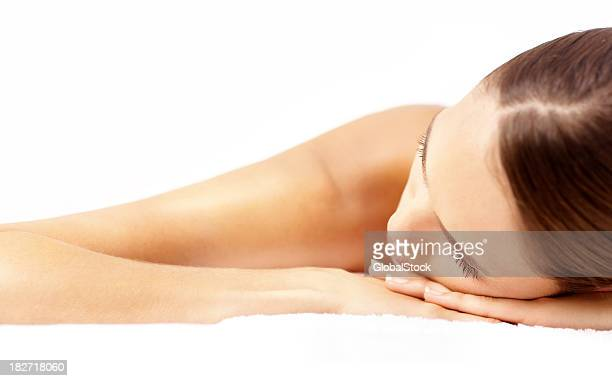 Close-up of a beautiful woman relaxing at spa