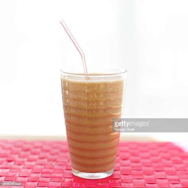 close-up of a beverage in a glass with a straw