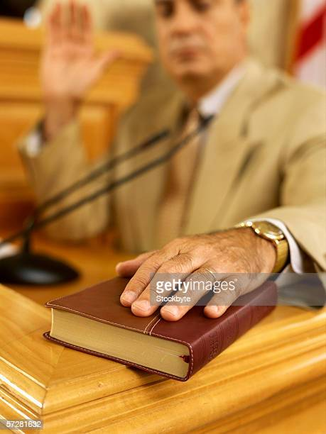 Close-up of a bible on which a witness is swearing