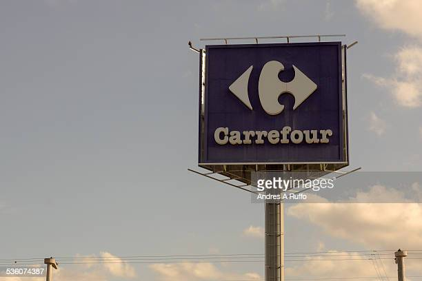 Closeup of a billboard with the logo of Carrefour with cloudy sky in the Shopping Villa Allende Province of Cordoba Argentina on Thursday evening...