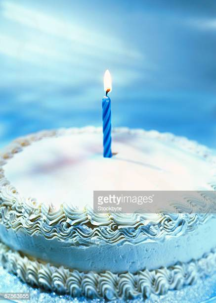 close-up of a birthday cake with a single candle on it