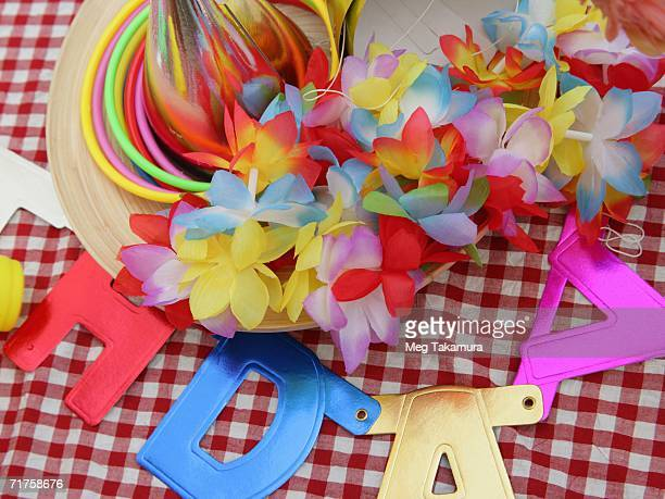 Close-up of a birthday hat and a garland on the table