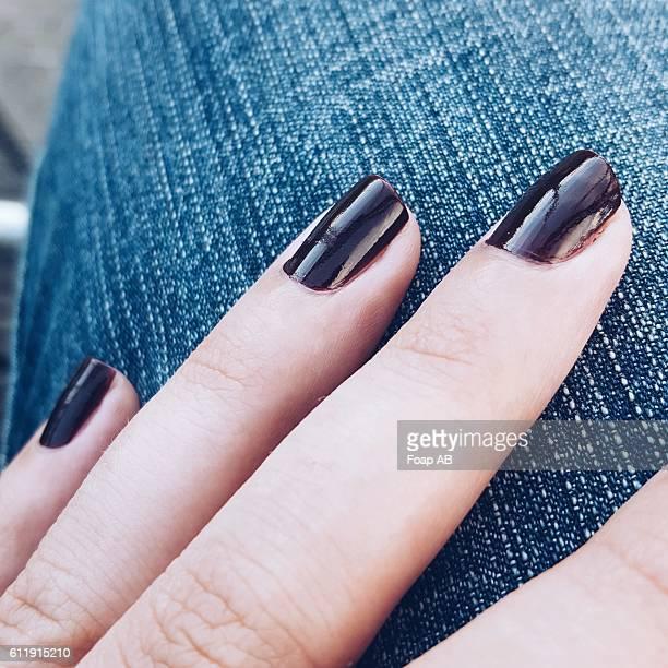 close-up of a black nail varnish - black nail polish stock photos and pictures