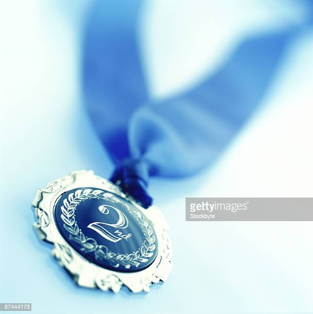 close-up of a blue medal marked 2
