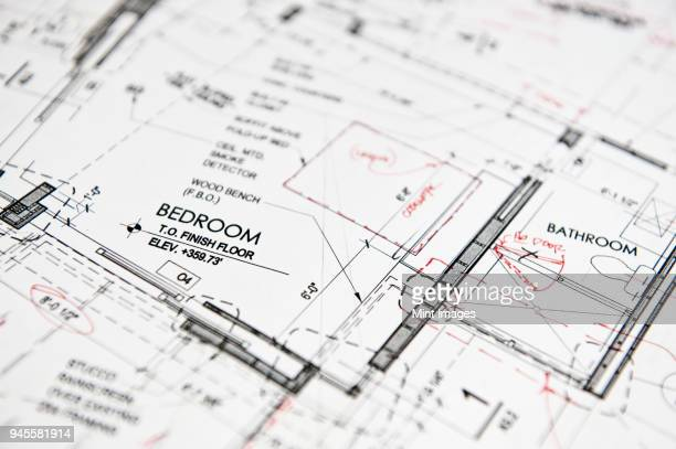 closeup of a blue print, architects drawing with red pen alterations, details of a bedroom and bathroom in a new home. - blueprint stock pictures, royalty-free photos & images