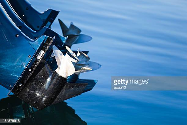 close-up of a boat's outboard motor and propellers - propeller stock pictures, royalty-free photos & images