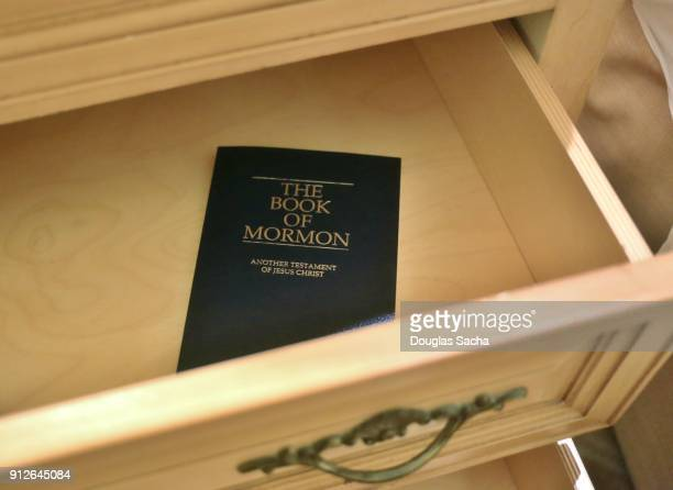 Close-up of a Book of Mormon in the dresser drawer of a hotel room