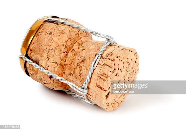Closeup of a bottle cork with wire on a white background