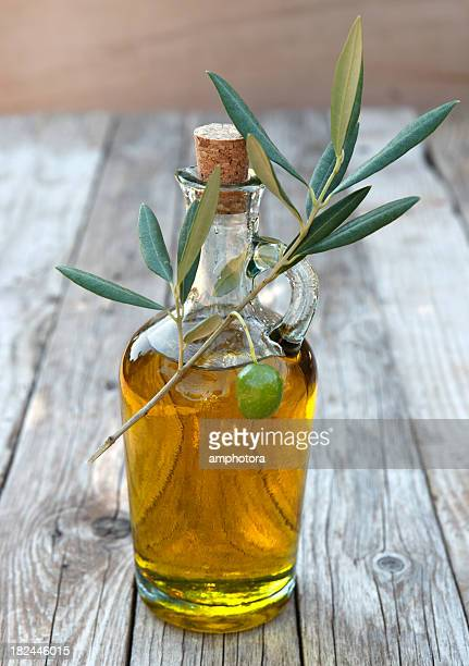 close-up of a bottle of olive oil - olive oil stock pictures, royalty-free photos & images