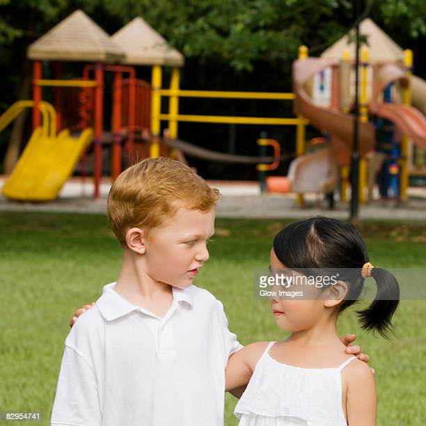 Close-up of a boy and a girl looking at each other