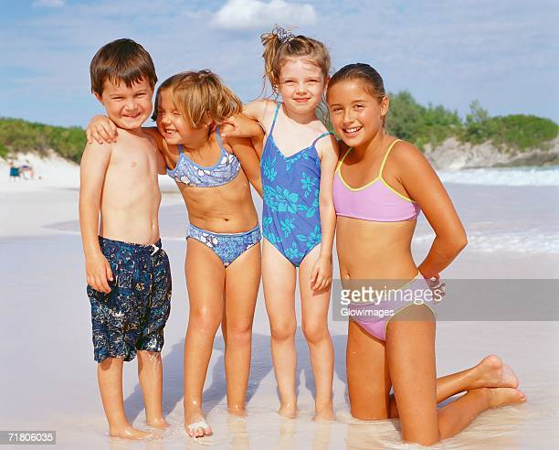 Close-up of a boy and his three sisters on the beach, Bermuda