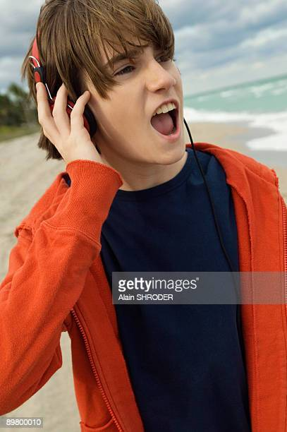 Close-up of a boy listening to headphones