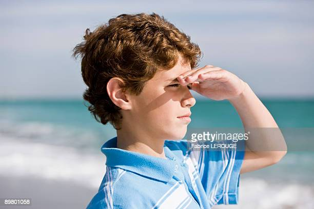 Close-up of a boy looking out to sea
