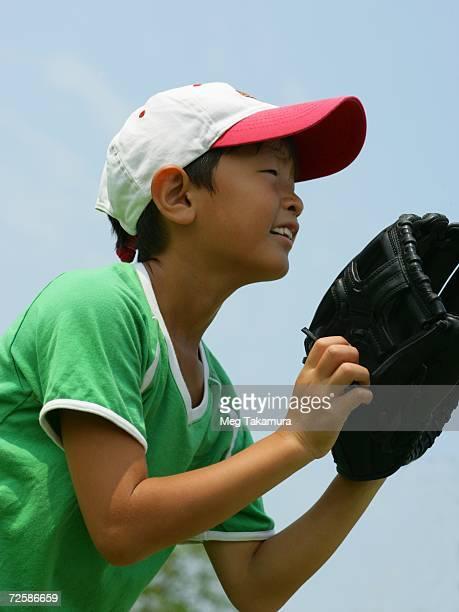 Close-up of a boy playing baseball