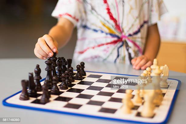 Close-up of a boy playing chess