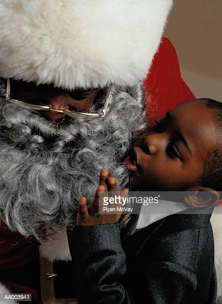 close-up of a boy talking to santa claus - santa close up stock pictures, royalty-free photos & images